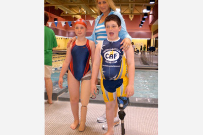 Brooke Artesi with 2 young campers - Challenged Athlete Foundation - Sunshine Prosthetics and Orthotics, Wayne NJ