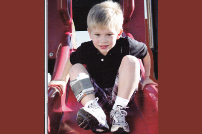 Child on slide wearing WalkAide pediatric unit for foot drop  - available at Sunshine Prosthetics and Orthotics in Northern NJ