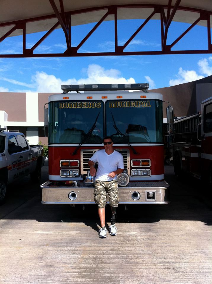 isaac feliciano in front of firetruck