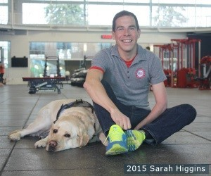 Billy Lister hangs out with his best friend, Potter, as they celebrate International Guide Dog Day at the U.S. Olympic Training Center in Colorado Springs, Colo.